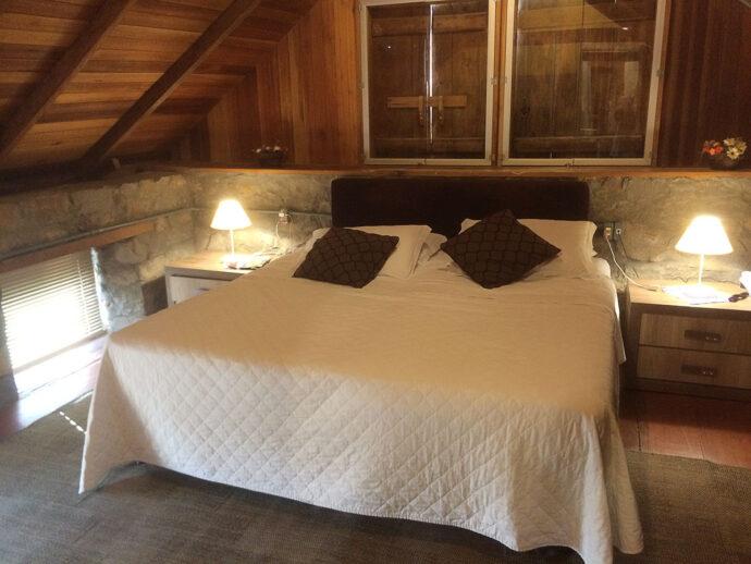 Apartamento Suíte ''Stanza Della Felicità'' situado no segundo andar da casa de pedra